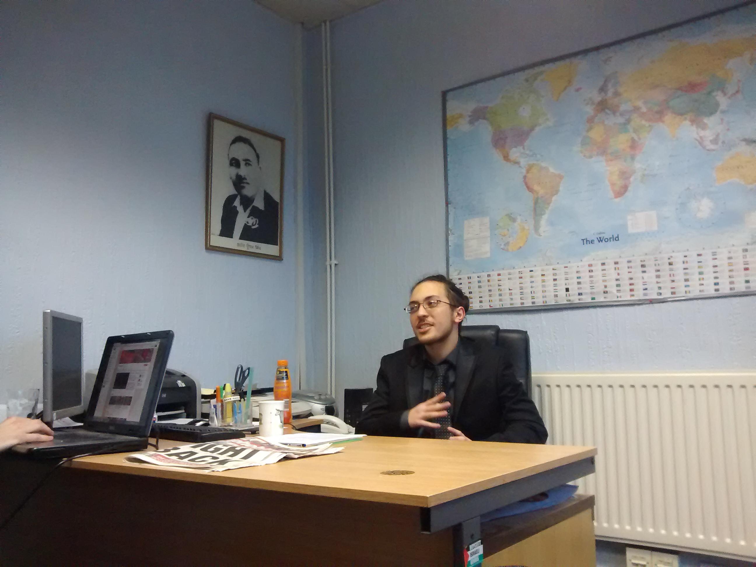 comrade Aberrabii speaks to the meeting in Birmingham